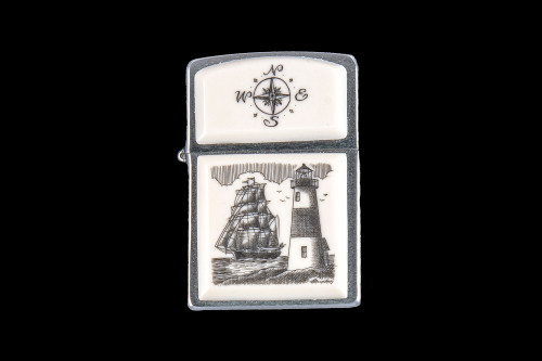 """This is a stunning Nautical designed Eco-Ivory Scrimshaw Ship and Lighthouse designed Zippo Lighter! The top of the flip lighter has a Compass Rose design. The Zippo is a Brushed Chrome finish. Each lighter has a bottom stamp signifying the year it was made, is refillable. All windproof lighters are American made in Bradford, PA factory and come packaged in a gift box. This is part of the Save the Elephant Collection and was originally hand etched by Linda Layden. The SKU is NC 54 - 406.  The Zippo Lighter is 2.24"""" x 1.51"""" x 0.59"""". It weighs 2.04 oz."""