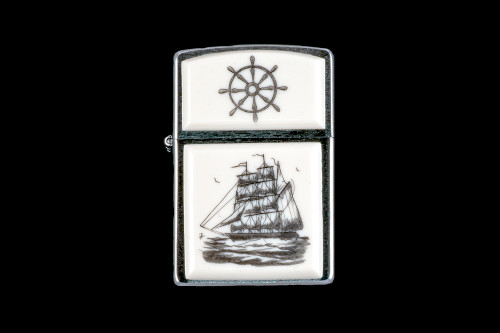 """This is a unique Nautical Style Eco-Ivory Scrimshaw Charles W. Morgan Ship designed Zippo Lighter! The top of the flip lighter has a Ship Wheel design. The Zippo is a Brushed Chrome finish. Each lighter has a bottom stamp signifying the year it was made, is refillable. All windproof lighters are American made in Bradford, PA factory and come packaged in a gift box. This is part of the Save the Elephant Collection and was originally hand etched by Bill Feeney. The SKU is NC 54 - 451.  The Zippo Lighter is 2.24"""" x 1.51"""" x 0.59"""". It weighs 2.04 oz.  Charles W. Morganis an American whaling ship built in 1841 that was active during the 19th and early 20th centuries. Ships of this type were used to harvest the blubber of whales for whale oil which was commonly used in lamps.Charles W. Morganhas served as a museum ship since the 1940s and is now an exhibit at the Mystic Seaportmuseum in Mystic, Connecticut.She is the world's oldest surviving merchant vessel and the only surviving wooden whaling ship from the 19th century American merchant fleet.The Morgan was designated a National Historic Landmarkin 1966!"""