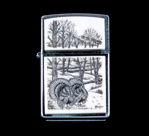 """This is a beautiful originally hand etched Eco-Ivory Scrimshaw Turkey Designed Zippo! In the detailed image is a hunter along the tree line. The top of the flip lighter has a Mountain View with Tree's design. The Zippo is a Brushed Chrome finish. Each lighter has a bottom stamp signifying the year it was made, is refillable. All windproof lighters are American made in Bradford, PA factory and come packaged in a gift box. This is part of the Save the Elephant Collection and was originally hand etched by Linda Layden. The SKU is NC 54 - 168.  The Zippo Lighter is 2.24"""" x 1.51"""" x 0.59"""". It weighs 2.04 oz."""