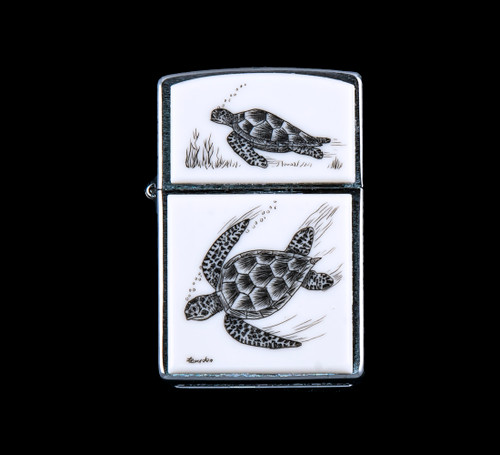 """This is a unique originally hand etched Eco-Ivory Scrimshaw Sea Turtle Designed Zippo! The top of the flip lighter has a Sea Turtle rose design. The Zippo is a Brushed Chrome finish. Each lighter has a bottom stamp signifying the year it was made, is refillable. All windproof lighters are American made in Bradford, PA factory and come packaged in a gift box. This is part of the Save the Elephant Collection and was originally hand etched by Linda Layden. The SKU is NC 54 - 405.  The Zippo Lighter is 2.24"""" x 1.51"""" x 0.59"""". It weighs 2.04 oz."""