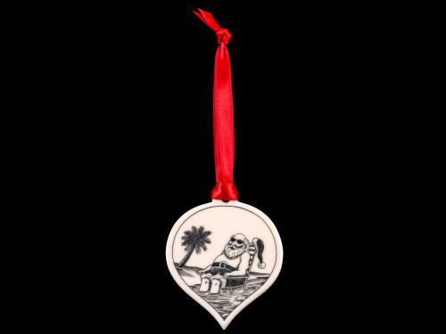 """This is a beautiful etched teardrop ornament with a Beach Santa Scene. This is part of our Save the Elephant Collection that we make, with the wonderful artist Linda Layden. The dimensions of the ornament are 1.91"""" x 1.37"""" x 0.12"""". The SKU is NC 50T - 05S  On this teardrop ornament is a stunning etched Beach Santa design. With the tropical Santa design on one side, the back has a sanded finish."""