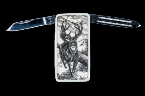 "Deer NC 20K Open.  This beautiful originally hand etched Deer design on a Large Rectangle Knife Money Clip.  This unique money clip has a small knife blade and a nail filer.  This is a practical money clip that duals as a practical knife.  The artwork was originally hand etched by Linda Layden.  The dimensions of the Large Rectangle Knife Money Clip with the blade(s) closed are 2.08"" x 1.32"" x 0.30"".  The knife blade itself is approximately 1.45"" and the nail file is approximately 1.50"", making the width of the money clip with both open 5.03"".  The SKU is NC 20K - 103A.  Linda Layden has been making beautiful works of art in the scrimshaw field for over 40 years.  Originally a hobby that became a full time job.  Her work can be found in gift shops, galleries and museums across the world."
