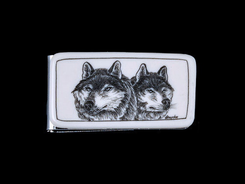 """This stunning originally hand etched Double Wolf design on a Large Slide Rectangle Money Clip. This unique piece is a slide money clip.  The artwork was originally hand etched by Linda Layden. The dimensions of the Large Rectangle Money Clip is 2.08"""" x 1.32"""" x 0.30"""". The SKU is NC 20 - 105A."""