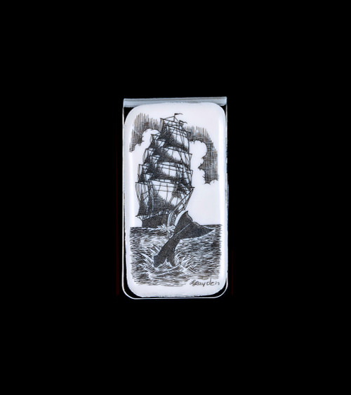 "This beautiful originally hand etched Ship and Whale design on a Large Slide Rectangle Money Clip.  This unique piece is a slide money clip.  The artwork was originally hand etched by Linda Layden.  The dimensions of the Large Rectangle Money Clip is 2.08"" x 1.32"" x 0.30"".  The SKU is NC 20 - 403."
