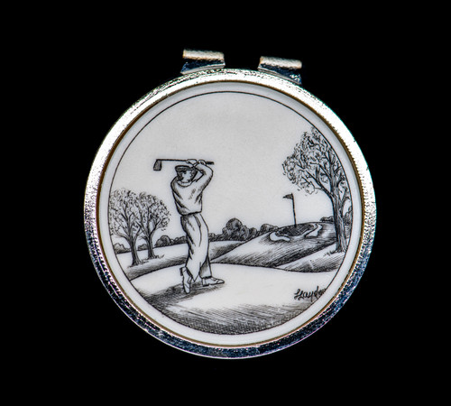 """Golfer Money Clip.  This stunning originally hand etched Golfer design on a Rond Spring Money Clip. This unique piece is a spring money clip. The back of the money clip has a stainless steel spring that will hold your money secure. Regardless if it is a small or large stack of bills.  The artwork was originally hand etched by Linda Layden. The artistic insert is an 1.5"""", the size of a silver dollar. The dimensions of the Large Rectangle Money Clip is 1.68"""" x 1.81"""" x 0.46"""". The SKU is NC 24 - 152."""