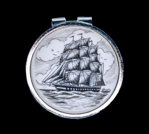 """Tall Ship Spring Money Clip. This stunning originally hand etched Tall Ship design on a Rond Spring Money Clip. This unique piece is a spring money clip. The back of the money clip has a stainless steel spring that will hold your money secure. Regardless if it is a small or large stack of bills.  The artwork was originally hand etched by Linda Layden. The artistic insert is an 1.5"""", the size of a silver dollar. The dimensions of the Large Rectangle Money Clip is 1.68"""" x 1.81"""" x 0.46"""". The SKU is NC 24 - 401."""