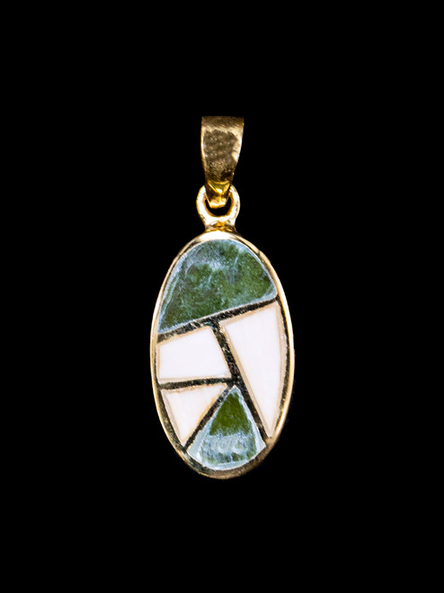 """Small Oval Alaskan Mammoth Jade Inlay 14K Gold Pendant  This lovely small oval shaped Alaskan Mammoth Jade is inlayed into a 14K Gold pendant with 14K Gold bars. This pendant comes with an 18"""" 14K Gold chain. The dimensions of the Alaskan Mammoth Jade pendant is approximately .68"""" x .35"""". The product id # is PMJ-1065-G  It is a 14K plate on sterling silver. The plating is with 30mils of 14k gold. Typically plating is done with 3mils of gold. We work with the extra gold plating to ensure your beautiful jewelry piece will have a strong gold color for years to come!!   The pre-historic Mammoth tusks are found as a bi - product of the gold mining industry in Alaska. They are carbon dated to be approximately 25,800 years old. The color of your mammoth tusk may vary due to the minerals in the ground water where the tusks are buried. The varying color of the mammoth tusks make each piece of jewelry unique. Cracks and splits in the ivory occur naturally due to it's great age. Our materials are considered eco-friendly because no animals were harmed in the making of this beautiful piece of jewelry.  Genuine Jade (nephrite) is a fascinating gemstone and the state gem of Alaska. In prehistoric times, prized for its toughness, jade was used to make weapons, tools and later simple ornaments. Jade purportedly can protect you from evil, attract love and of course bring you good luck. It is now regarded as a symbol of energy and beauty. Stimulating creativity and mental agility along with harmony and balance. The jade we use comes from the Nana Region of Alaska."""