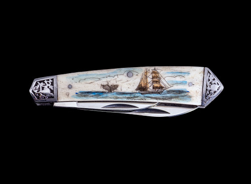"Ship and Whale DB 2222.  This stunning hand etched Colored Ship and Whale scene on a 440 Stainless Steel Dual Blade Knife.  The knife design is similar to the Shrade 2222 knife.  This beautiful knife is part of the Scrimshaw Collection, with those words laser engraved into the blade.  The DB 2222 knifes come with the pictured leather sheath and each scale is made with Bovine Bone.  The DB 2222 knife has bolsters that are nickel silver with brass pins and liner.  It is a dual blade knife and a very useful pocket knife.  The dimensions of the DB 2222 Pocket Knife with the blade closed are 3.48"" x 0.90"" x 0.58"".  The large blade itself is approximately 2.67"" making the width of the knife with an open blades 6.15"".  The small blades length is approximately 1.90"".  The SKU is DB 2222 - 403CV.  The scrimshaw is inked with colored india ink and sealed with renaissance wax, which is used by museums for antique restoration.  It also helps bring out the beauty of the artwork as well as in the cow bone. The knife is water resistant, but not waterproof."