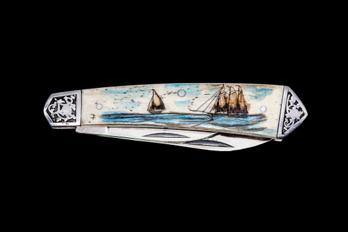 "DB 2222 401 DC Dual Blade Knife.  This unique hand etched Vertical Double Tall Ship Nautical Scene on a 440 Stainless Steel Dual Blade Knife.  The knife design is similar to the Shrade 2222 knife.  This beautiful knife is part of the Scrimshaw Collection, with those words laser engraved into the blade.  The DB 2222 knifes come with the pictured leather sheath and each scale is made with Bovine Bone.  The DB 2222 knife has bolsters that are nickel silver with brass pins and liner.  It is a dual blade knife and a very useful pocket knife.  The dimensions of the DB 2222 Pocket Knife with the blade closed are 3.48"" x 0.90"" x 0.58"".  The large blade itself is approximately 2.67"" making the width of the knife with an open blades 6.15"".  The small blades length is approximately 1.90"".  The SKU is DB 2222 - 401DC.  The scrimshaw is inked with colored india ink and sealed with renaissance wax, which is used by museums for antique restoration.  It also helps bring out the beauty of the artwork as well as in the cow bone. The knife is water resistant, but not waterproof."