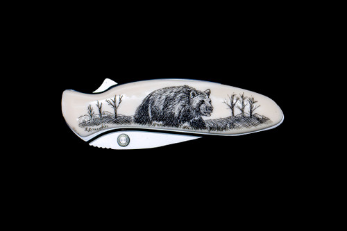 """NC 1600 Chive Bear Pocket Knife.  This stunning originally hand etched Bear design on a Kershaw 1600 Chive Speedsafe Assisted Opening Pocket Knife. The back of the knife has a belt clip/ money clip and the knifes come with the pictured sheath. It is a lock blade knife and a useful pocket knife. The artwork was originally hand etched by Linda Layden. The dimensions of the Kershaw 1600 Chive Pocket knife with the blade closed are 2.95"""" x 0.92"""" x 0.53"""". The blade itself is approximately 1.9"""" making the width of the knife with an open blade 4.85"""". The SKU is NC 1600 - 102.  Linda Layden has been making beautiful works of art in the scrimshaw field for over 40 years. Originally a hobby that became a full time job. Her work can be found in gift shops, galleries and museums across the world.  It is a bead-blasted 1. 9"""" high-performance blade made of 420HC steel offers good edge retention and excellent corrosion resistance. With a matching stainless steel handle is resistant to corrosion and also finished with a non-reflective matte bead-blasted finish. The acrylic resin is placed on top of the handle. Handle features SpeedSafe assisted opening, secure frame lock, Tip-lock slider and convenient single-position pocket clip. Capable of everyday cutting tasks at home or at work such as cutting zip-ties, stripping small wire, slicing fruit and removing staples. Perfect for everyday carry in a pocket, purse, backpack, briefcase, on a belt or around the neck with the handle's predrilled lanyard hole."""