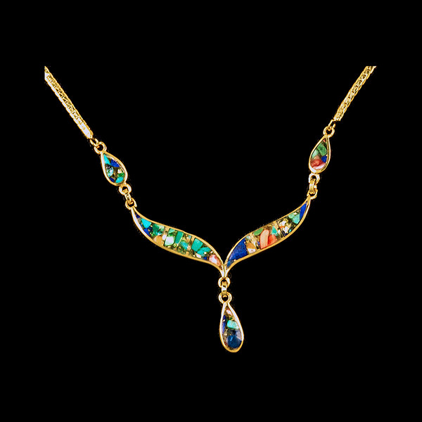 """This unique whale tail with Teardrop Mammoth Northern Lights shaped whale tail is inlayed into a 14K Gold pendant. This pendant comes with an 18"""" 14K Gold chain. The dimensions of the Northern Light pendant is approximately 2.25"""" x 1.7"""". The product id # is PNL-1008-G."""