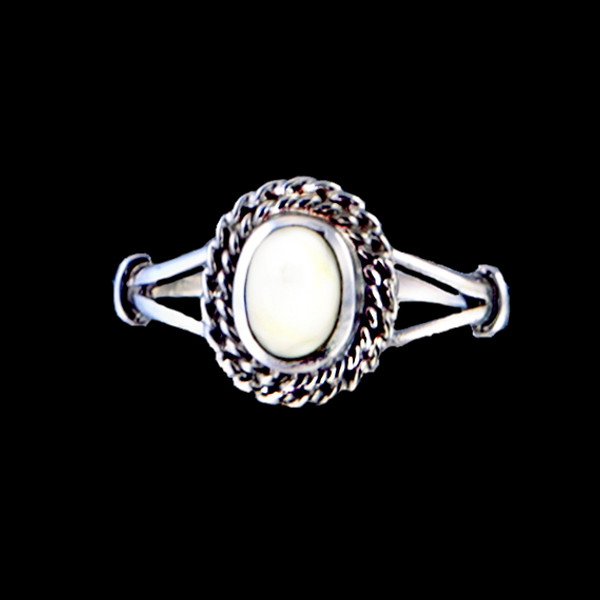 "This breathtaking oval shaped mammoth ivory design is inlayed into a elegant sterling silver ring with a rope border.  The dimension of the stone on the ring is approximately .36"" x .415""."
