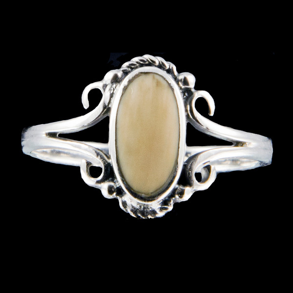 "This charming victorian oval shaped mammoth ivory design is inlayed into a elegant sterling silver ring.  The dimension of the stone on the ring is approximately .236"" x .394""."