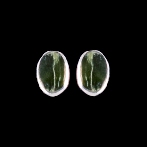 """This classy oval Alaskan Jade is inlayed into a beautiful Sterling Silver earring. These unique earrings have a post backing. The measurements of the earrings are approximately .33""""x.22""""."""