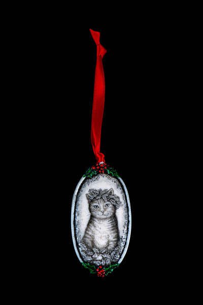 "Cat with Crown This is a beautiful double sided ornament with a Cat theme.  This is part of the incredible line of Mossup Valley Designs that we carry, with the wonderful artist Rachel Badeau.  The dimensions of the ornament are 3.28"" x 1.61"".  The SKU is MVD ORN 11."