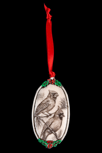 """This is a beautiful double sided ornament with a Bird theme. This is part of the incredible line of Mossup Valley Designs that we carry, with the wonderful artist Rachel Badeau. The dimensions of the ornament are 3.28"""" x 1.61"""". The SKU is MVD ORN 6.  On this double sided ornament, a Bird if prominently featured on both sides. On one side there is Cardinal design. On the other side of the ornament, there is a Robin  Rachel Badeau has been etching and engraving in a variety of media for over thirty years. Her work, characterized by fine line and intricate detail, attempts to touch the hearts and emotions of others. All while reflecting her love of animals, nature and the human spirit."""