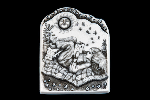"""This is a gorgeous wall plaque was originally hand etched Between the Pages Wall Plaque design. This is part of the incredible line of Mossup Valley Designs that we carry, with the wonderful artist Rachel Badeau. The dimensions of the plaque are 4.52"""" x 5.67"""" x 0.49"""". The SKU is MVD WP 8.  Rachel Badeau has been etching and engraving in a variety of media for over thirty years. Her work, characterized by fine line and intricate detail, attempts to touch the hearts and emotions of others. All while reflecting her love of animals, nature and the human spirit.  The resin scrimshaw piece is originally hand etched by Rachel Badeau. We make a mold of the original piece and do an open cast pour of our resin mixture. The pieces are removed from the mold and sanded and inked."""