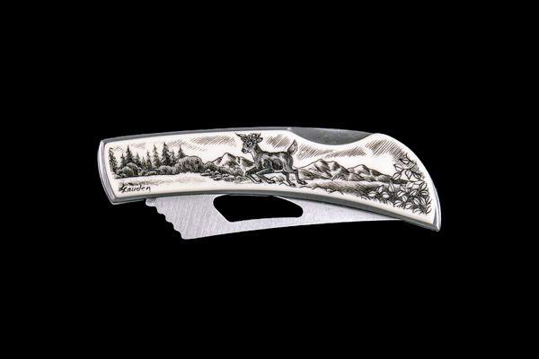 """This stunning originally hand etched Jumping Deer design on a Stainless Steel Silver Hawk Knife. The back of the knife has a belt clip and all the knifes come with the pictured sheath. It is a lock blade knife and a useful pocket knife. The artwork was originally hand etched by Linda Layden. The dimensions of the Silver Hawk knife with the blade closed are 3.00"""" x 0.96"""" x 0.55"""". The blade itself is approximately 2.35"""" making the width of the knife with an open blade 5.35"""". The SKU is NC 14 - 103A.  Linda Layden has been making beautiful works of art in the scrimshaw field for over 40 years. Originally a hobby that became a full time job. Her work can be found in gift shops, galleries and museums across the world."""