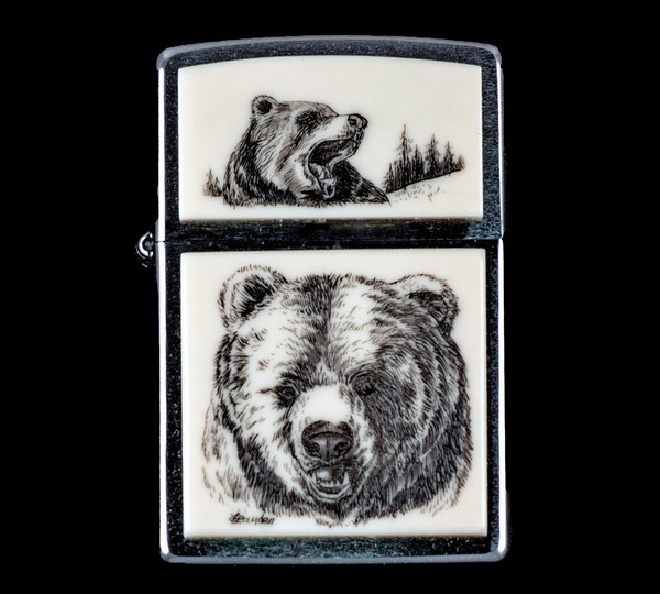 "This is a stunning originally hand etched Eco-Ivory Scrimshaw Bear Face Designed Zippo! The top of the flip lighter has a Roaring Bear design.  The Zippo is a Brushed Chrome finish. Each lighter has a bottom stamp signifying the year it was made, is refillable. All windproof lighters are American made in Bradford, PA factory and come packaged in a gift box.  This is part of the Save the Elephant Collection and was originally hand etched by Linda Layden.  The SKU is NC 54 - 151.  The Zippo Lighter is 2.24"" x 1.51"" x 0.59"".  It weighs 2.04 oz."