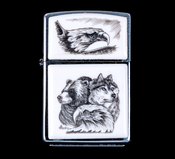 "This is a beautiful originally hand etched Eco-Ivory Scrimshaw Bear, Wolf and Eagle Face Designed Zippo! The top of the flip lighter has a Eagle design.  The Zippo is a Brushed Chrome finish. Each lighter has a bottom stamp signifying the year it was made, is refillable. All windproof lighters are American made in Bradford, PA factory and come packaged in a gift box.  This is part of the Save the Elephant Collection and was originally hand etched by Linda Layden.  The SKU is NC 54 - 165.  The Zippo Lighter is 2.24"" x 1.51"" x 0.59"".  It weighs 2.04 oz."
