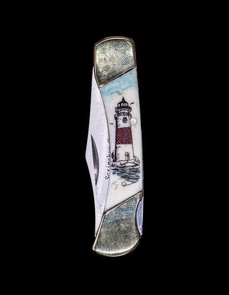 "This sharp hand etched Colored Lighthouse design on a 440 Stainless Steel Blade LB 3 Knife. The depicted lighthouse is Sankaty Head Light on Nantucket, MA.  This beautiful knife is part of the Scrimshaw Collection, with those words laser engraved into the blade.  The LB 3 knifes come with the pictured leather sheath and each scale is made with Bovine Bone.  The LB 3 Knife has bolsters and shackle that are nickel silver with brass pins and liner.  It is a lock blade knife and a very useful pocket knife. The dimensions of the LB 3 Pocket Knife with the blade closed are 2.97"" x 0.76"" x 0.31"".  The blade itself is approximately 2.21"" making the width of the knife with an open blade 5.18"".  The SKU is LB-3 436."
