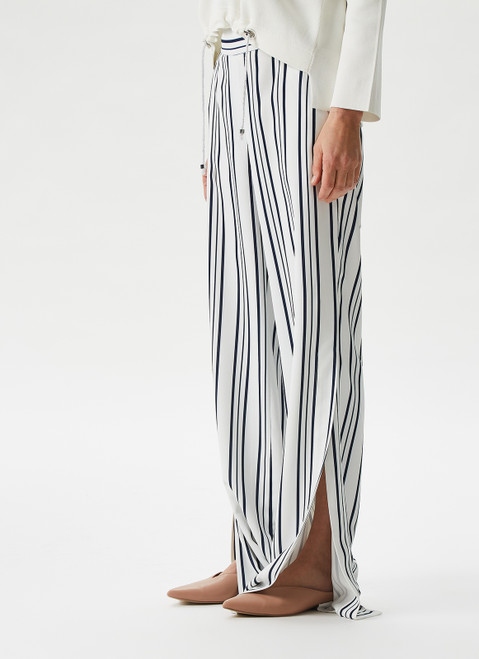 BLACK AND WHITE FLUID TROUSERS WITH SIDE MAXI-SLITS
