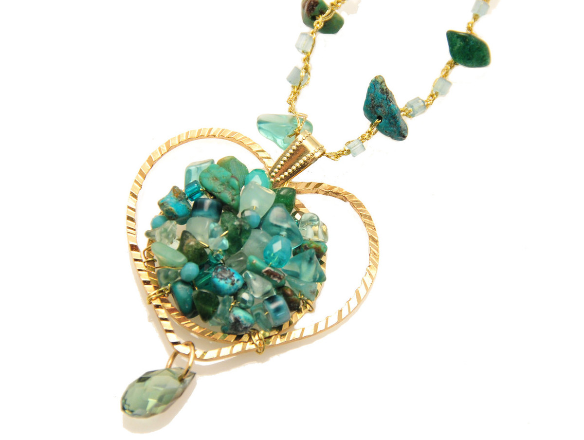Anat Collection Long heart shape pendant filled with natural stones Necklace