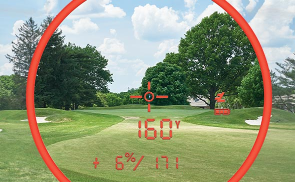 Bushnell Golf PRO XE laser rangefinder and GPS photo through scope showcasing 7X magnification and accurate readings at over 500 yards.