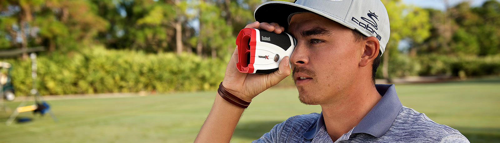 Rickie Fowler using a Bushnell Golf Tour V4 Shift Laser Rangefinder.