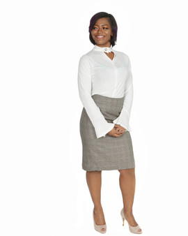 Crème long bell sleeve shirt with tan and black plaid skirt