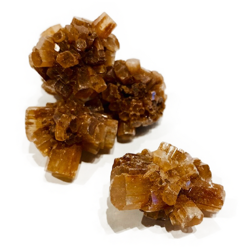 Centering and grounding crystal. Boosts self-confidence and self-worth. Assists with emotional stability.