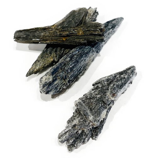 Black Kyanite. Alligns all chakras with emphasis on grounding. Releases anger and confusion. Enhances dreams and past life recall.