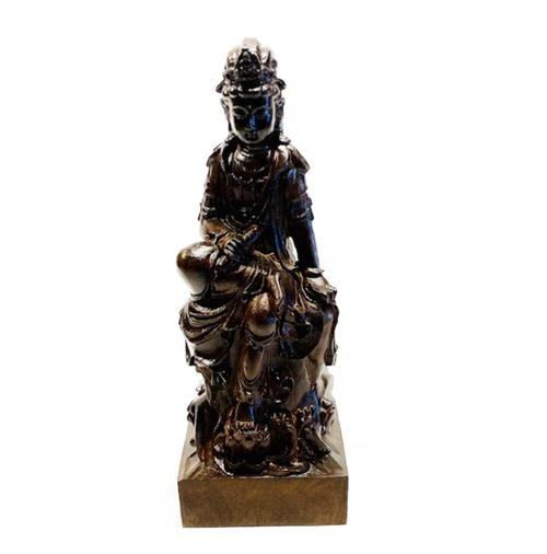 "Agarwood laser cut 10"" Sitting Kwan Yin statue. Indoor use recommended. Agarwood: Mystical resin used in meditation to unlock the subconscious and balance Chi. Provides clarity and grounding."