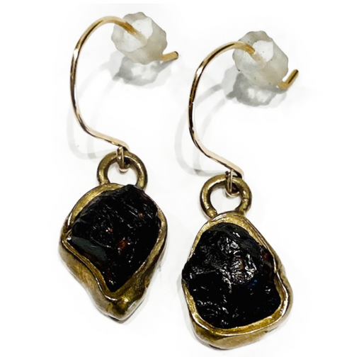 Handmade in Los Angeles. Brass earrings with bezel raw garnets. Wire at ear is gold-fill. Garnet: Health, Commitment & Devotion.
