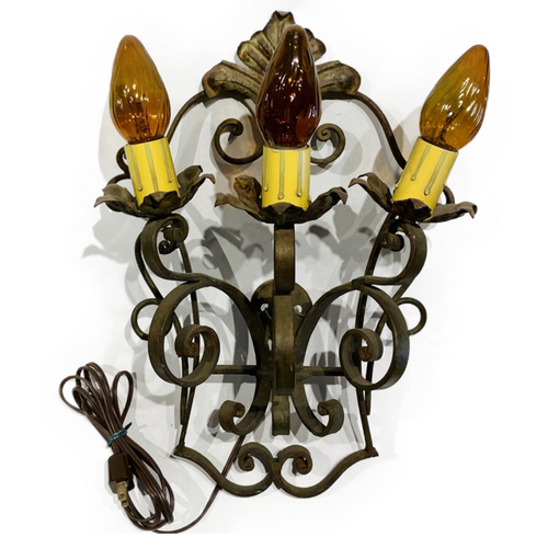 Vintage wall sconce. Single. Heavy gauge iron. Electric cord, but can be hot wired by electrician. Spanish Revival look. Recommended for interior use or covered exterior patio or entrance. PICKUP ONLY ITEM.