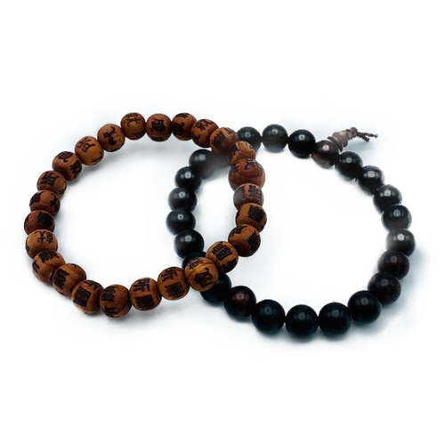 """Tibetan wooden bracelet. Stretch cord. One size fits all. Unisex Rosewood Prayer Beads: Protective and shields one from negative energy. Also known for healing, circulation and manifesting. Korean Zen Cedar Prayer Beads: Inscription reads, """"Where you place your will, there you will achieve."""""""