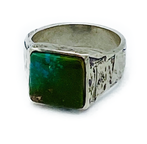 Handmade sterling silver ring with genuine Arizona Turquoise setting. Size 10 (additional sizes available upon request) Made in Los Angeles. Turquoise: Connections one to the spiritual world, psychic sensitivity and protection from harm and negative energy. Symbolizes friendship and brings peace to the home and good fortune to the owner.