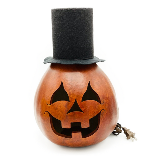 """Our Aum holiday tradition...Handmade in Carlisle, Pennsylvania. """"Mr. Arther"""" is an actual dried and preserved gourd. Gourds are flammable. DO NOT PUT NEAR an open flame. Includes orange, low watt light bulb and cord. NOTE: Due to size, this item is PICK UP only."""