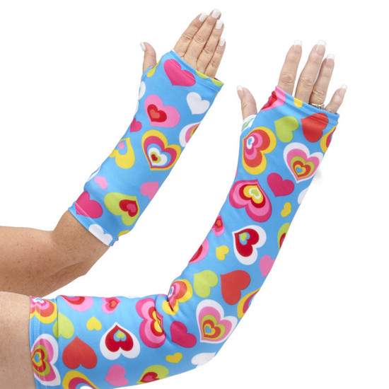 Long and short arm cast cover with colorful hearts on a blue background.  One of our most popular styles for kids.