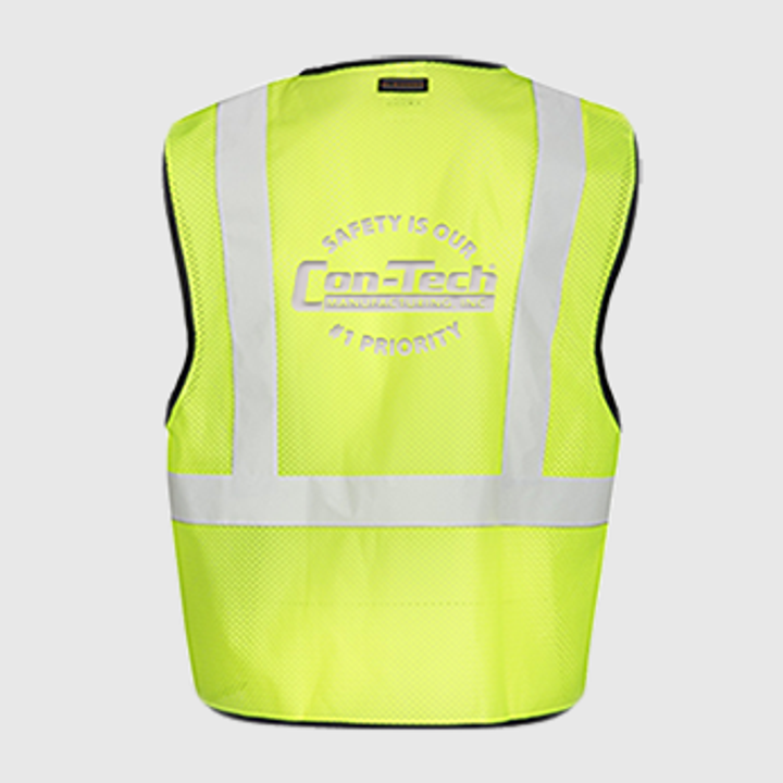 Construction safety vest, yellow, reflective materials.