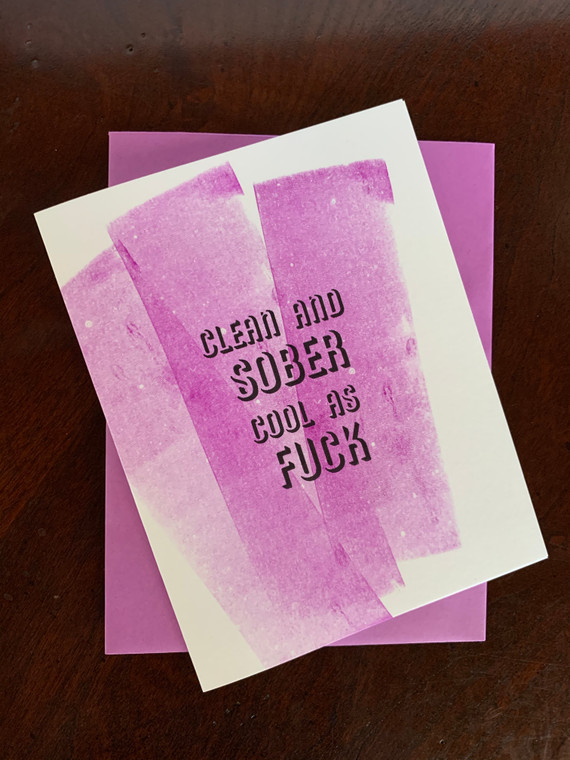 """Clean and Sober. Cool as Fuck. Celebrate another day sober with this high-end, hand-crafted card.  4.25"""" x 5.5"""" card is blank inside. Printed on heavyweight 100% cotton card stock. Includes a matching A2 envelope."""