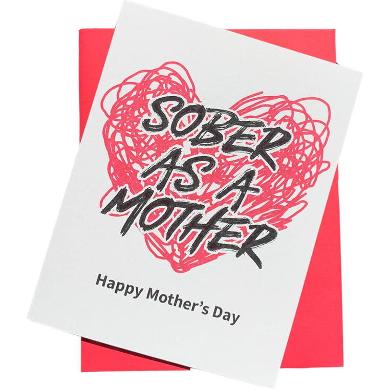 """Is your mom Sober As A Mother? She deserves to be celebrated extra hard this Mother's Day. Let her know how proud you are with this Sobriety Card just for Sober Badass Moms.Happy Mother's Day! 4.25"""" x 5.5"""" card is blank inside. Printed on heavyweight 100% cotton card stock. Includes a matching A2 envelope."""