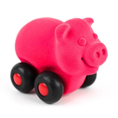 Pink pig on wheels
