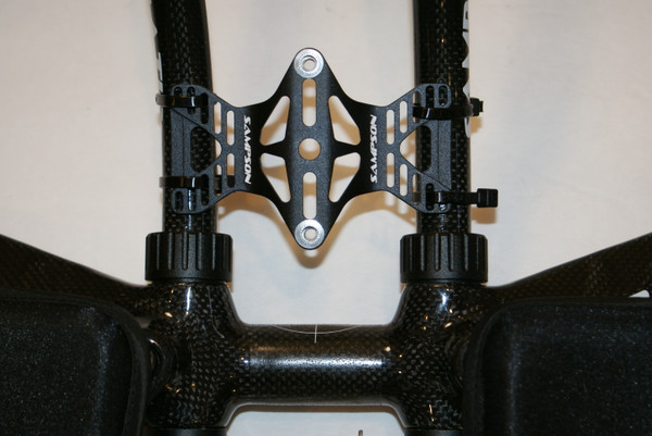 A BETWEEN THE ARMS BOTTLE MOUNT AND HIGH-GRIP CAGE IS INCLUDED