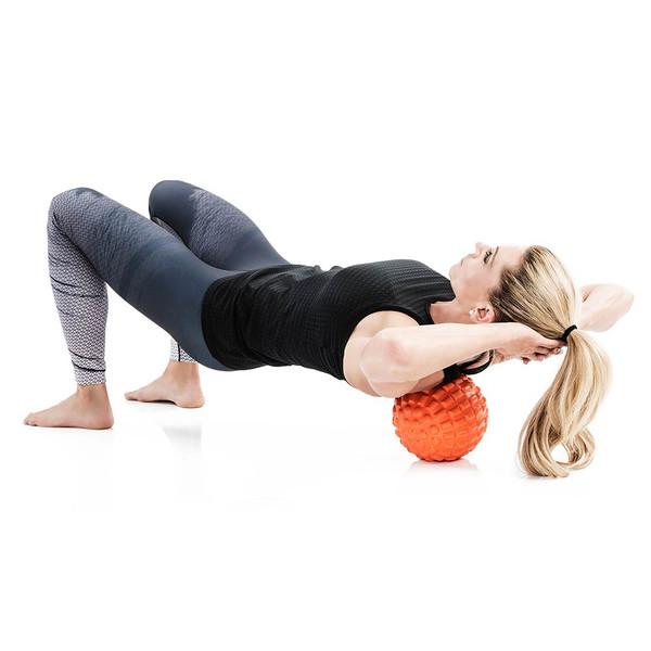Bionic Body Massage Ball used by Kim Lyons to massage back