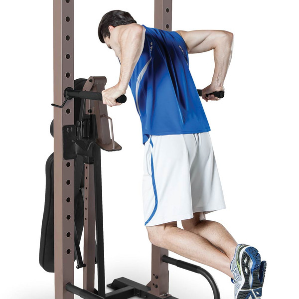 The Steelbody STB-98502 Power Tower with Foldable Bench in use - tricep dips