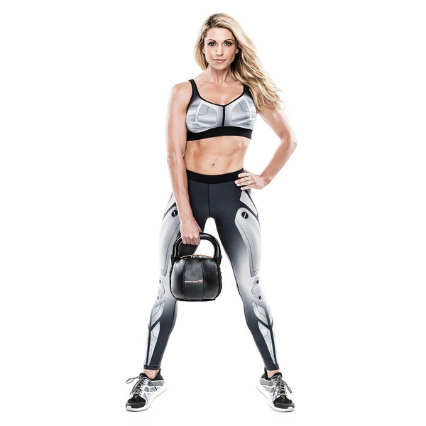 Bionic Body 15 lb. Soft Kettlebell held by Kim Lyons