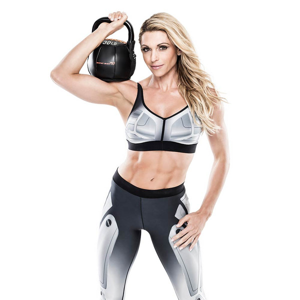 Bionic Body 30 lb. Soft Kettlebell held by Kim Lyons
