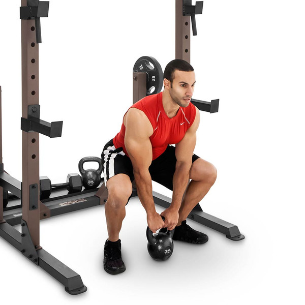 The Full Rack Utility Trainer SteelBody STB-98010 in use - overhead kettlebell raise