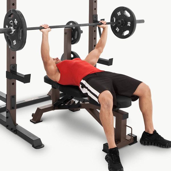 The Utility Bench STB-10105 by SteelBody in use - Olympic bar bench press